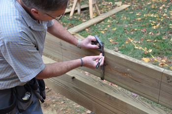 Use a sharpie or construction pencil to mark your joists.