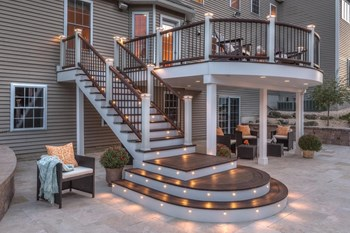 Elevated deck with lighting built into stairs, posts, and platform Elevated deck with lighting built into stairs, posts, and platform